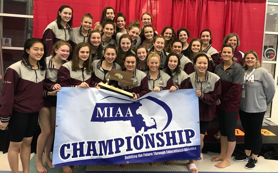 The Westford girls' swim team poses with the Division 1 championship trophy, the Grey Ghosts' fourth in a row.