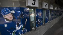Photos of Canucks players are pictured outside the closed box office of Rogers Arena in downtown Vancouver, British Columbia, this week. The NHL will let the team resume play Friday after a massive COVID-19 outbreak halted its season.