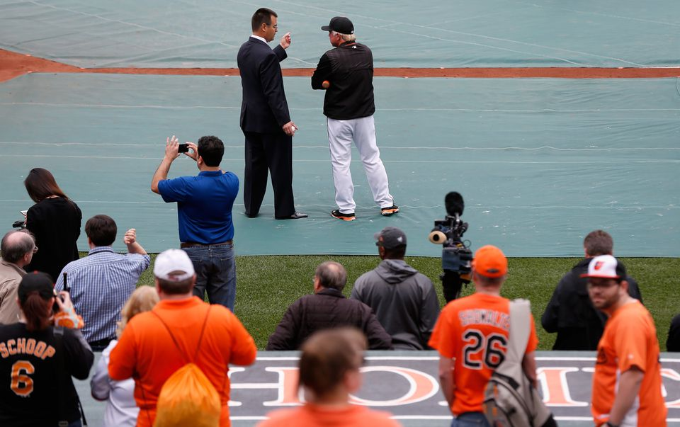 Dan Duquette (left), Buck Showalter, and the Orioles could use some help to boost their rotation.