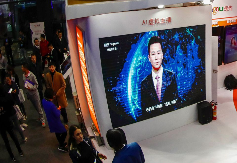 A screen shows an artificial intelligence news anchor introducing himself at the Light of Internet Expo in November in Wuzhen, China.