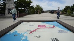 Visitors walked by a map of two Koreas showing North Korea's capital Pyongyang and South Korea's capital Seoul at the Imjingak Pavilion in Paju, near the border with North Korea, South Korea. North Korean leader Kim Jong Un's powerful sister, Kim Yo Jong, said Friday, North Korea is willing to resume talks with South Korea if it doesn't provoke the North with hostile policies and double standards.