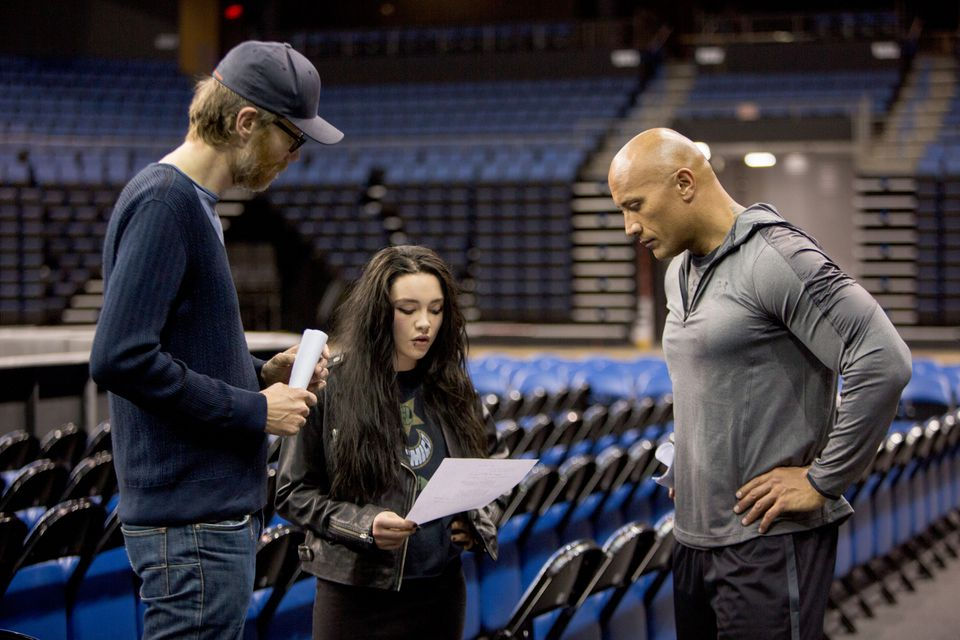 "Director Stephen Merchant (left), actor Florence Pugh (center) and actor Dwayne Johnson (right) on the set of ""Fighting With My Family."""