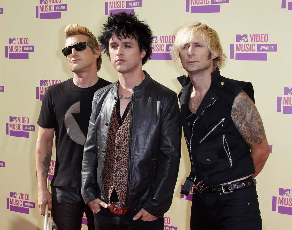 Green Day members (from left) Mike Dirnt, Billie Joe Armstrong, and Tre Cool in Los Angeles in 2012.