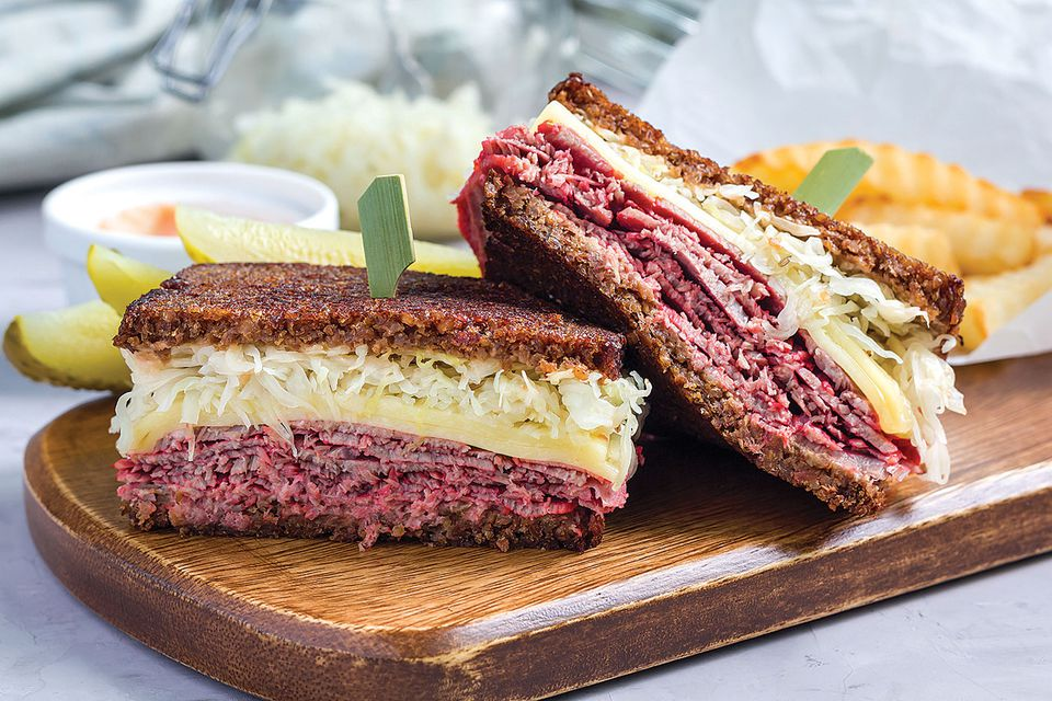 Russian versus Thousand Island dressing isn't the only question swirling around the Reuben sandwich; its origin is also a subject of debate. One legend credits the sandwich to Arnold Reuben, the owner of Reuben's Restaurant in New York City, and dates it to around 1914. Another story attributes it to players in a regular poker game at the Blackstone Hotel in Omaha, Nebraska, in the 1920s. That story centers on Reuben Kulakofsky, co-owner of Omaha's Central Market, and Blackstone owner Charles Schimmel, who put the sandwich on the hotel menu.
