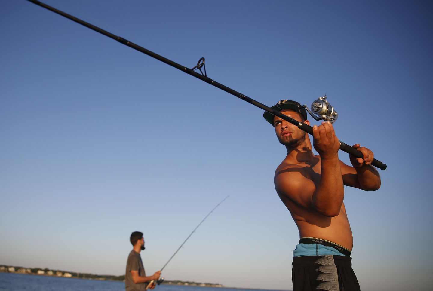 Josua Gonzalez of Springfield casts for striped bass at Rocky Neck State Park in East Lyme, Connecticut.