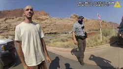 This Aug. 12, 2021 file photo from video provided by The Moab Police Department shows Brian Laundrie talking to a police officer after police pulled over the van he was traveling in with Gabby Petito, near the entrance to Arches National Park.