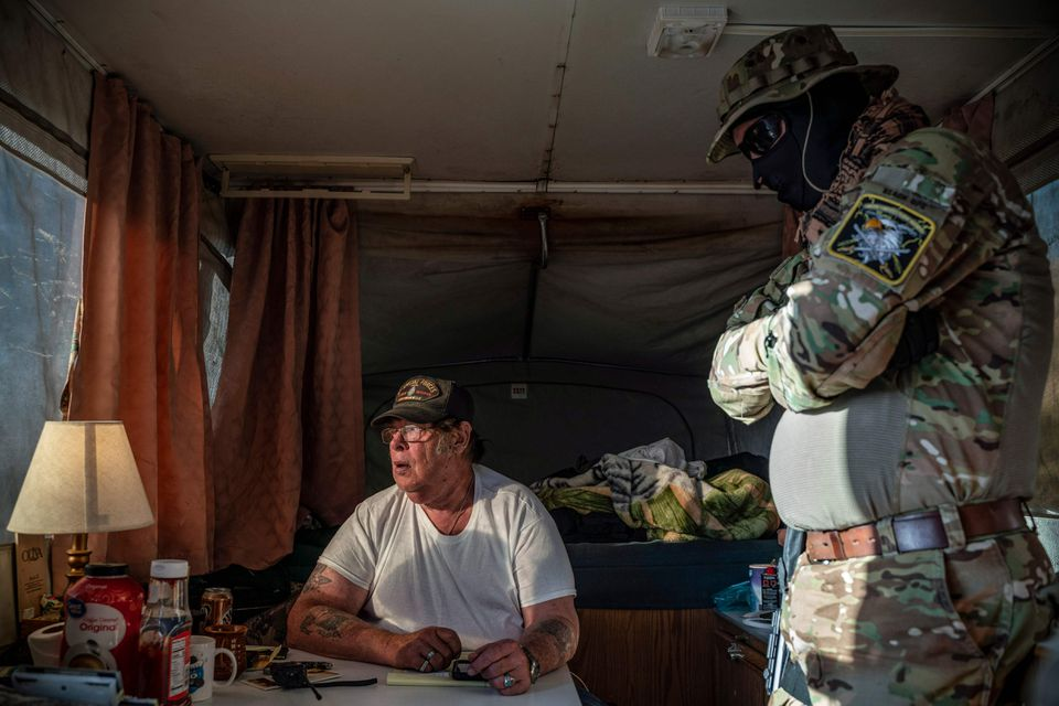 New Mexico militia leader Larry Mitchell Hopkins (left) inside the camper of the United Constitutional Patriots.