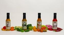 Brian Ruhlmann sources ghost peppers and habaneros from local growers for his Craic Sauces.
