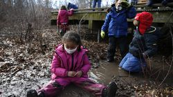 Members of the Magnificent Monarchs, a class for children ages 4 and 5, played in the mud during their school day at Boston Nature Center's Pathways to Nature Preschool program in January.