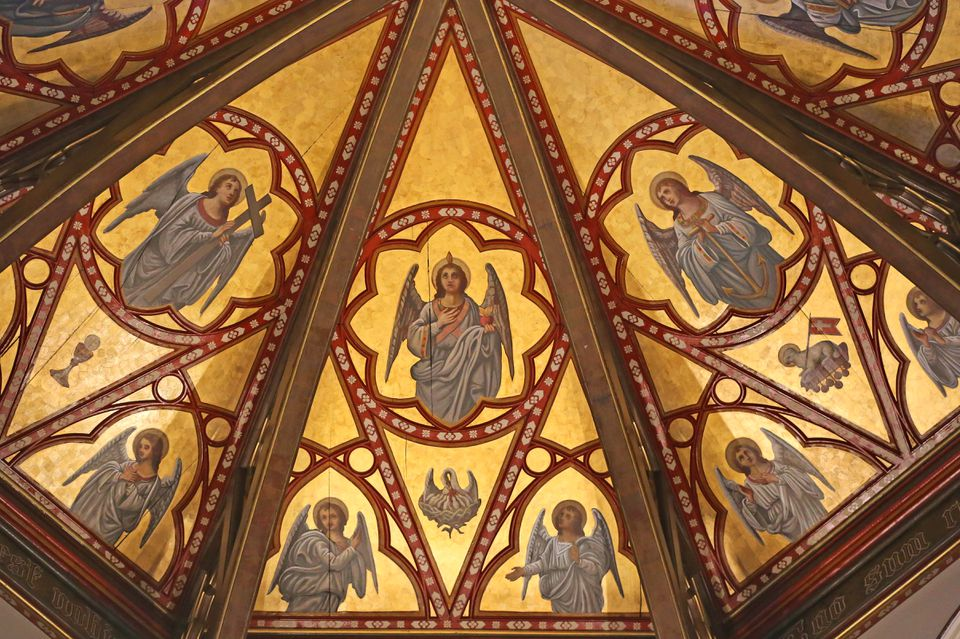 The ceiling panels above the cathedral's altar were restored.