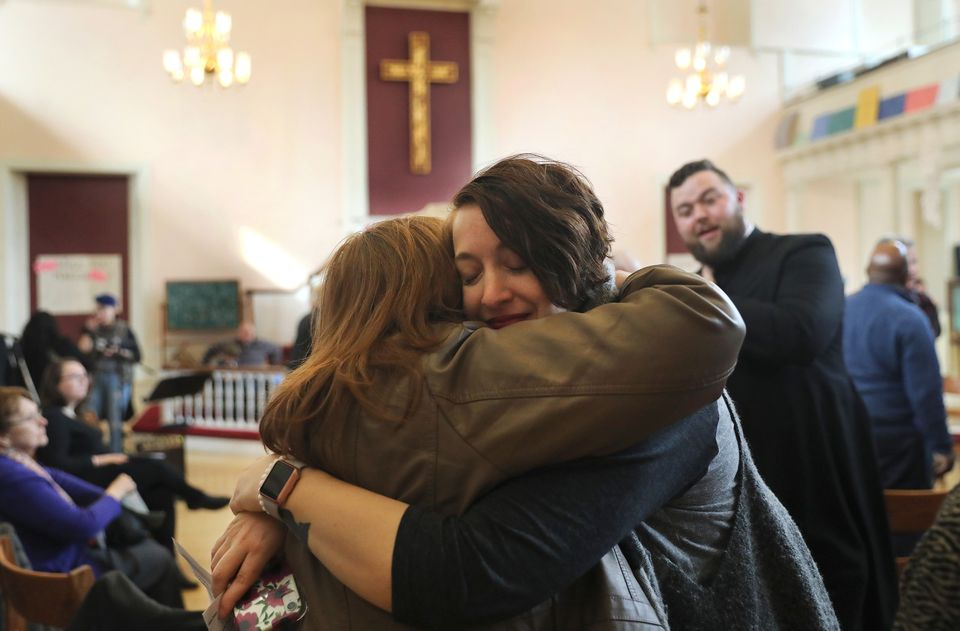 Chaplain Alexx Wood (left), from Bedford, embraced the Rev. Randi Rocco, from Sanbornville, N.H., last Sunday at Old West Church.