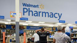 Shoppers wait in line to be served at the pharmacy of a Walmart store in North Carolina in 2018.