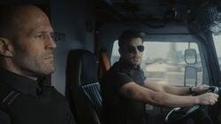 "Jason Statham, left, and Josh Hartnett in ""Wrath of Man."""