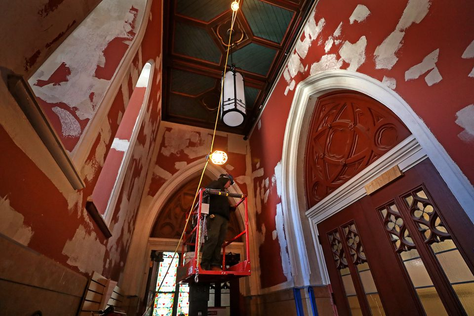 The front entrance of the cathedral was prepared for painting last week.
