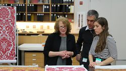 Senior textile conservator Tess Fredette (far left), Guillaume Verzier, of Prelle, and Sabine Verzier compared preparatory drawings to fragments of the original Titian Room fabrics at the Lyon factory in 2020.