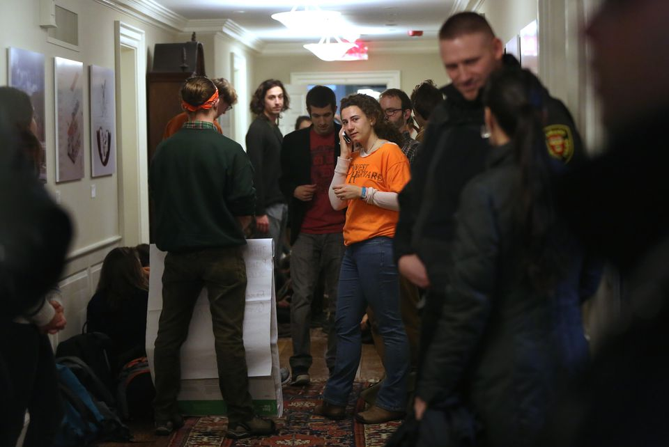 Chloe Maxmin, a senior and cofounder of Divest Harvard, gave a phone update to a reporter from The Harvard Crimson on students' activity in the hallway during the sit-in Thursday. The building was then closed to anyone unauthorized.