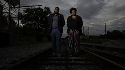 Ahoskie Mayor Weyling White, left, and Hertford County Magistrate Deborah Morrison, right, pose for a portrait on railroad tracks that divide the predominantly White and predominantly Black parts of town in Ahoskie, N.C., Wednesday, Sept. 9, 2020. (Photo © Landon Bost 2020)