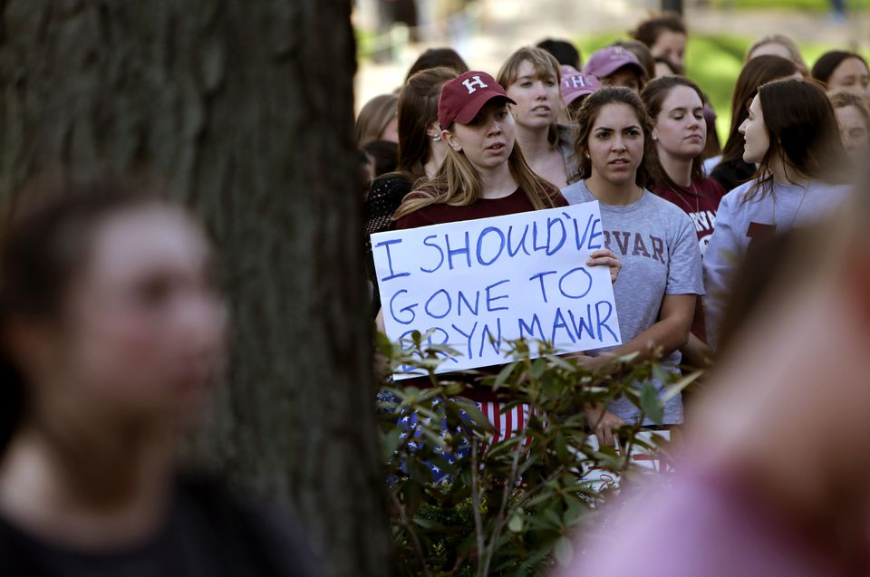 Demonstrators gathered outside Massachusetts Hall Monday before their rally and march around Harvard Yard.
