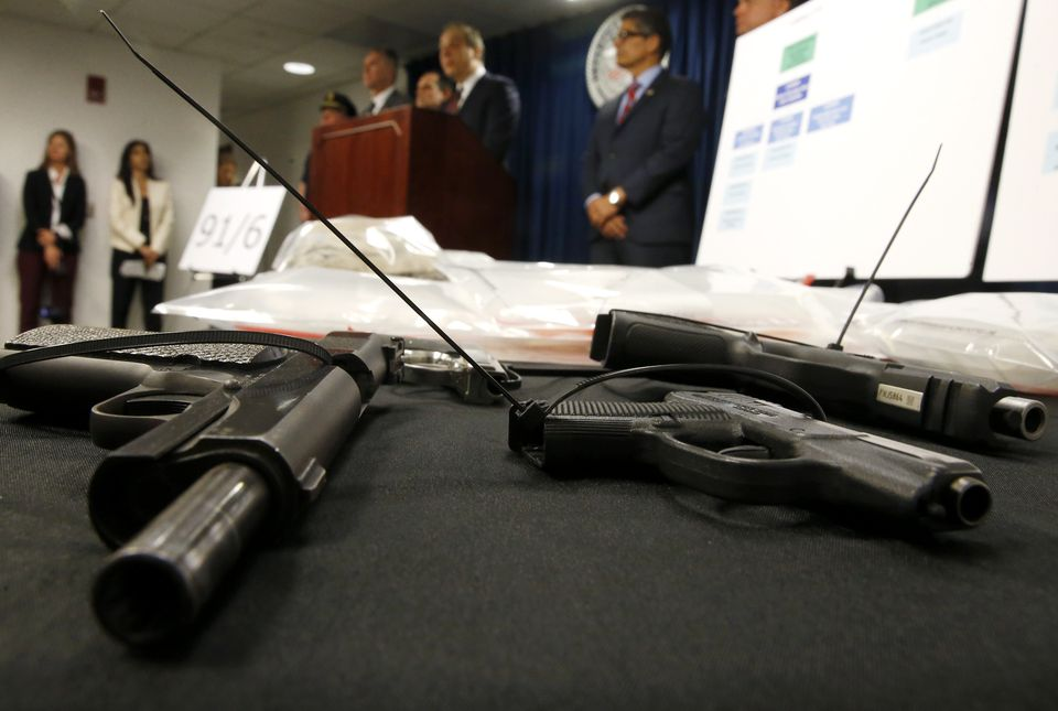 Confiscated firearms were seen as authorities announced federal drug, firearm and immigration charges against 30 defendants from the city of Lawrence and surrounding communities at Moakley Federal Courthouse in Boston.