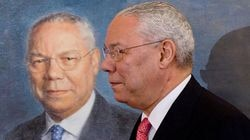 Former secretary of state Colin Powell stands alongside his official State Department portrait following the unveiling in the Benjamin Franklin Room at the State Department in Washington on Dec. 7, 2009. He died Monday of COVID-related complications, and had been vaccinated.
