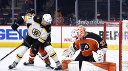 Philadelphia Flyers goaltender Brian Elliott makes a save on a shot attempt by Bruin Nick Ritchie.