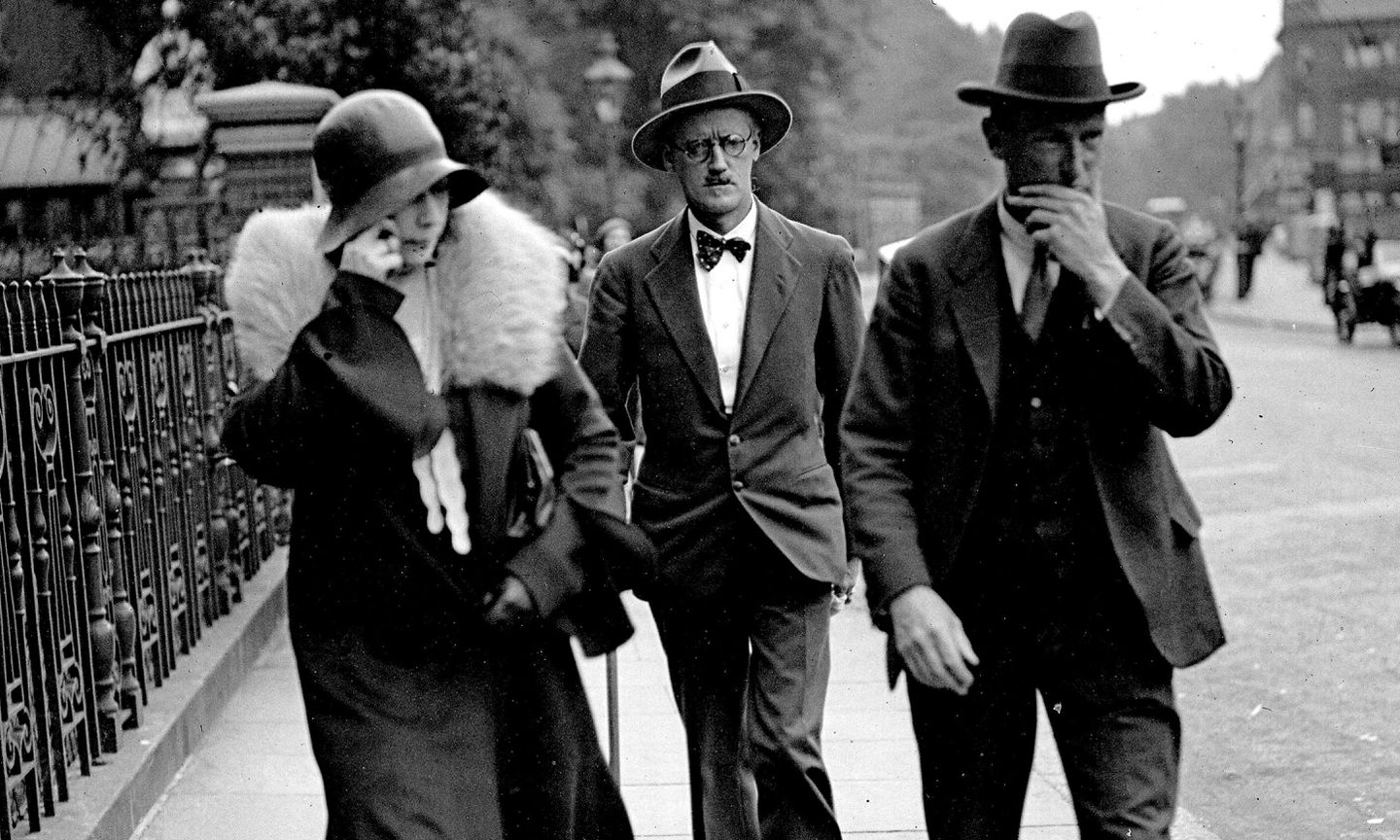 Nora Barnacle and James Joyce (center) in London on the day of their marriage, July 4th, 1931.