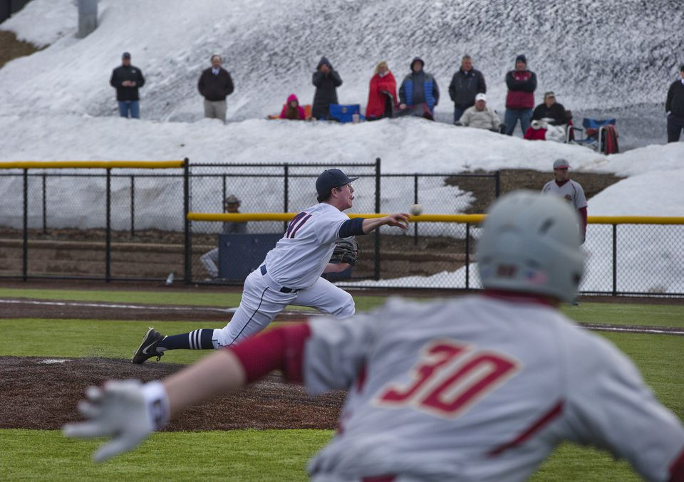 Boston College and the University of Connecticut faced off at the New England Baseball Complex in Northborough, where three fields are in high demand while many area college diamonds are still buried in snow. Specialists with heavy equipment cleared 5-foot drifts to make the synthetic fields ready.