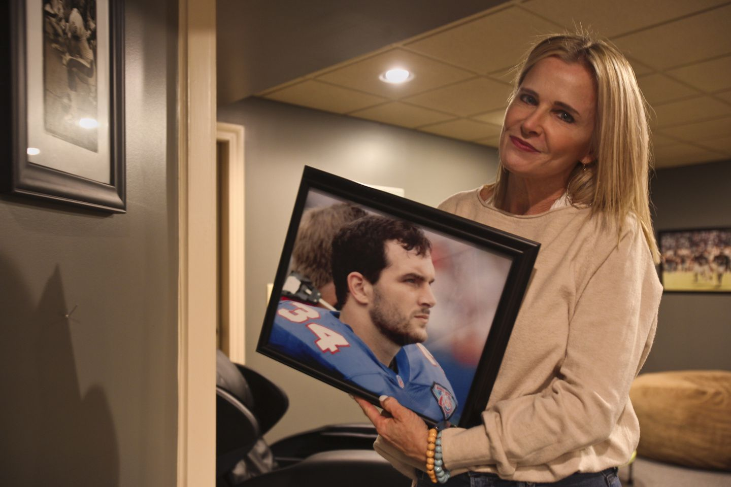 Joyce Turner, Kevin Turner's first wife and the mother of his children, with her favorite photograph of him.