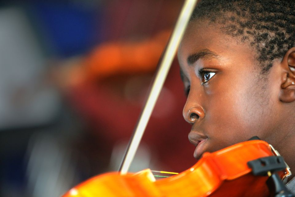 David Ugbe, 9, played his violin in Bridge Boston's music room.