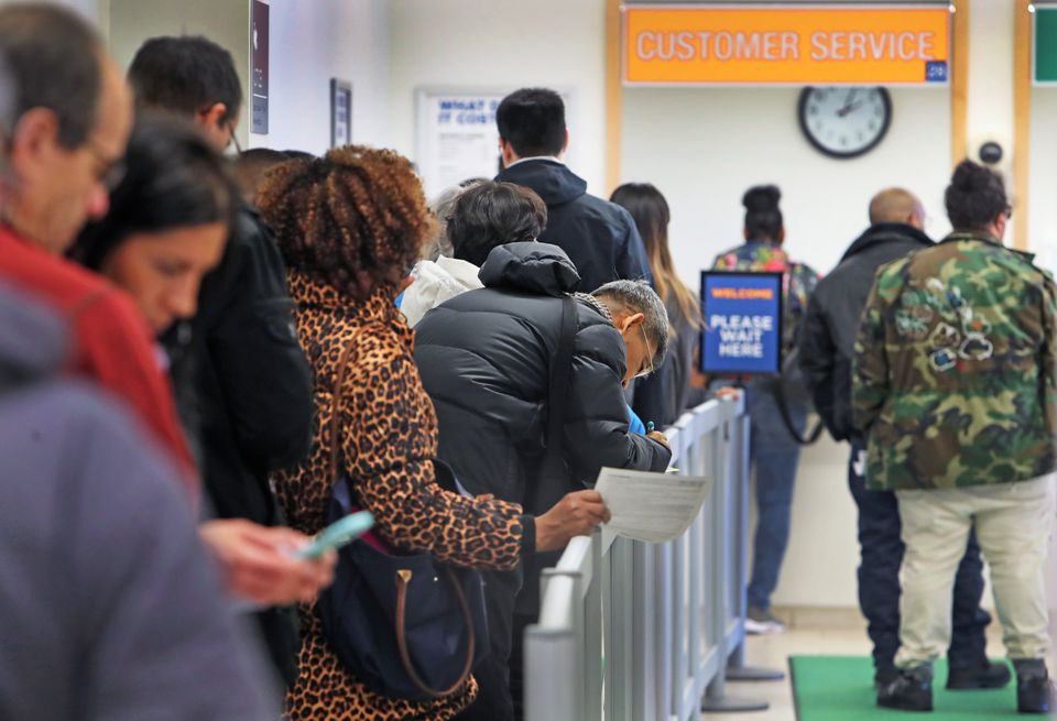 People arrived at the Registry of Motor Vehicles office on Blackstone Street in Boston were informed that their estimated wait time would be four hours.