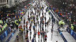Runners make their way down Boylston Street in the rain last year.