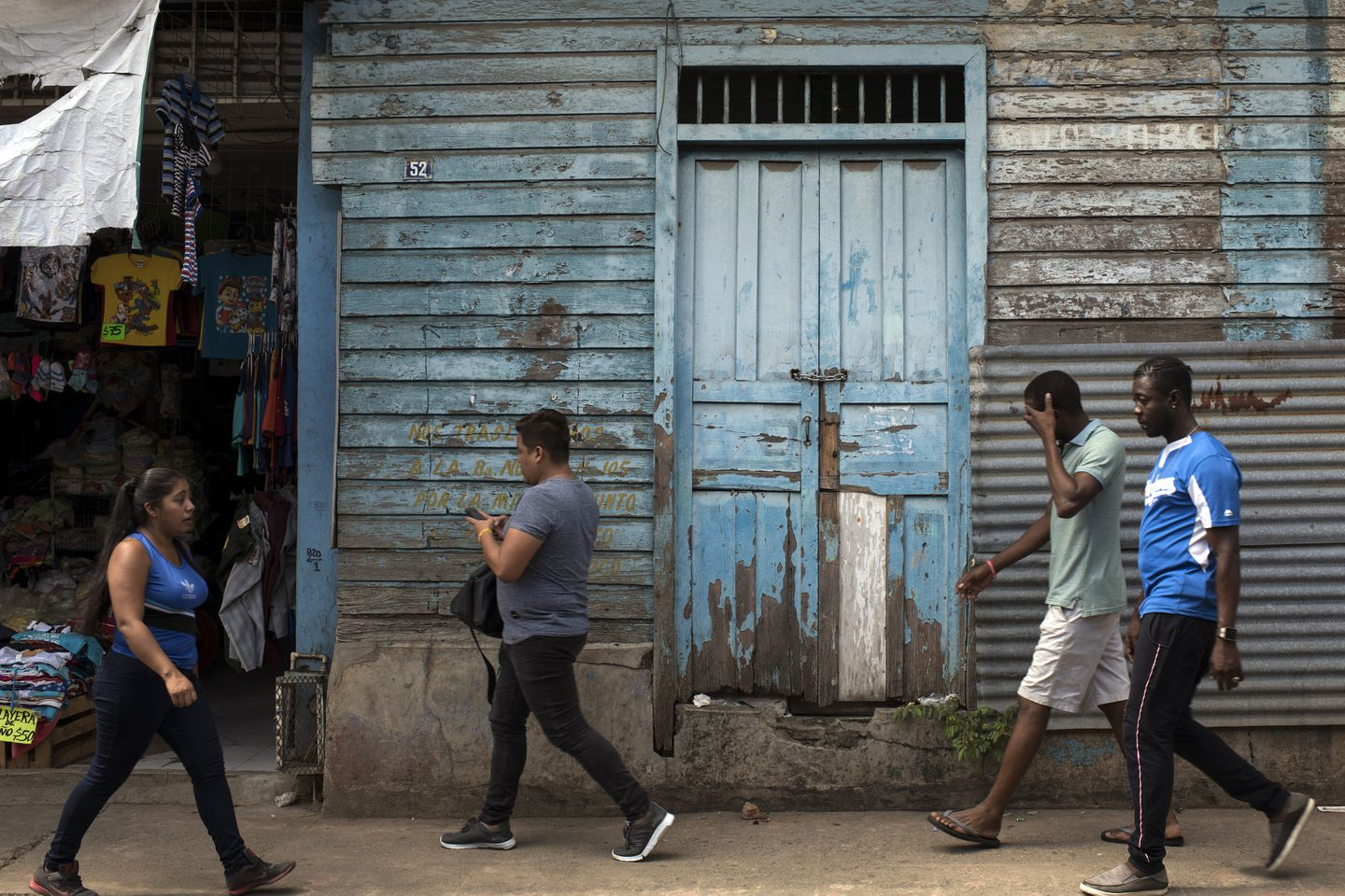 African migrants walk in the streets of Tapachula, heading to the central park. The arrival of African and other migrants is changing the demographics of this Mexican town.