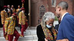 Janet Jemmott Moses, widow of Robert Parris Moses, outside St. Mary's of the Annunciation Church after Saturday's service for her late husband.