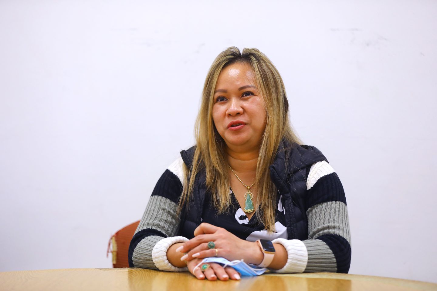 Nail salon worker Amy Nguyen has had her work hours slashed because of effects of the coronavirus pandemic. A single mother of two who emigrated to Boston from Vietnam 18 years ago, she is pictured in the offices of VietAID, a nonprofit serving Vietnamese immigrants in Fields Corner.