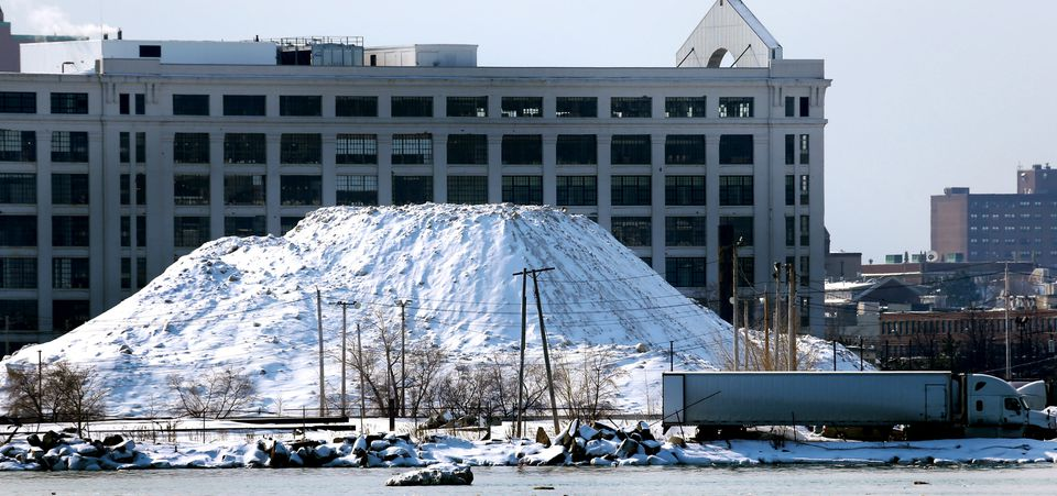 By Feb. 19, the mountain, shown with 666 Summer St. in the background, was several stories high.