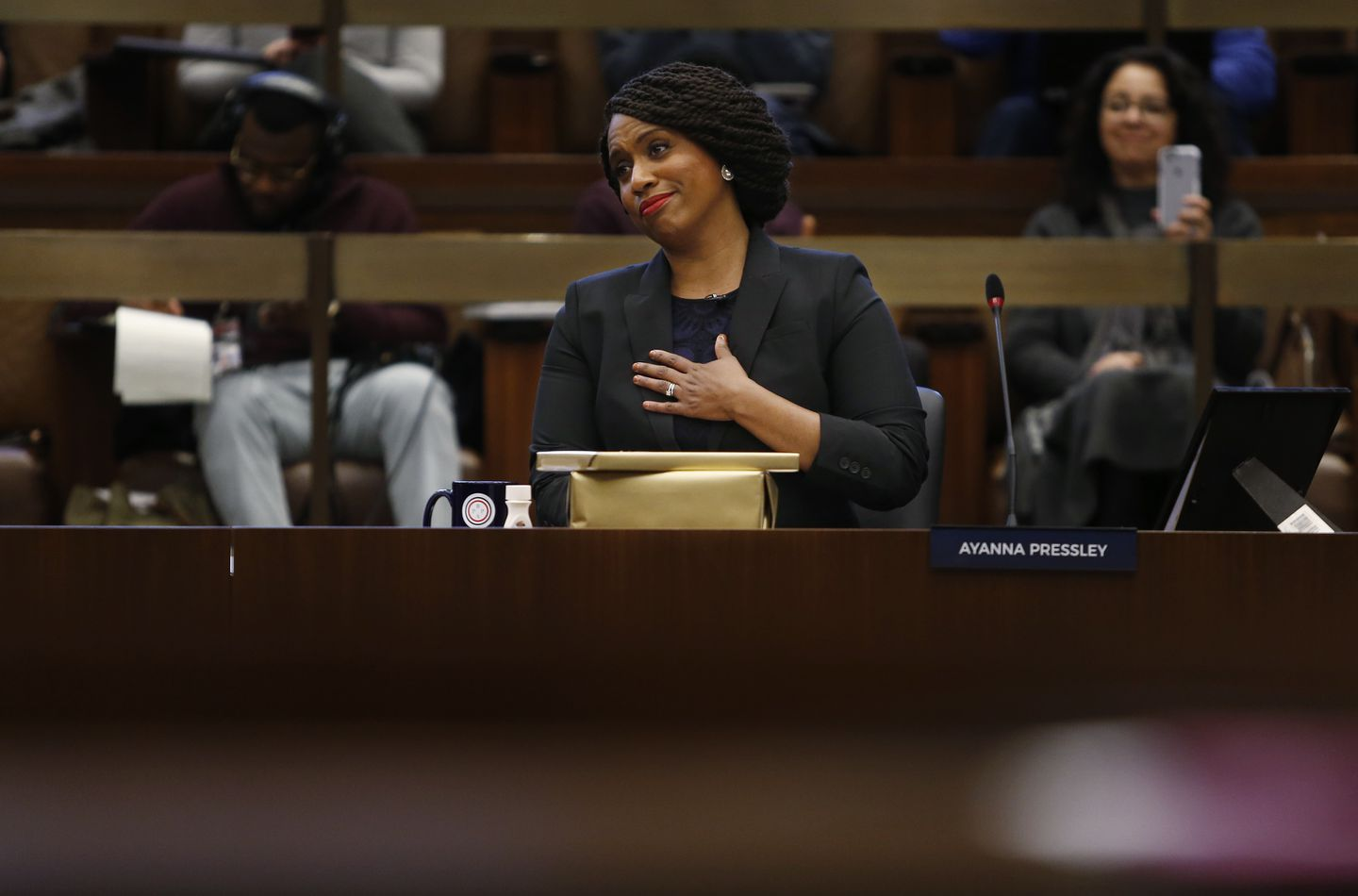 Congresswoman-elect Ayanna Pressley gestured as a fellow City Councilor wished her farewell at City Hall.
