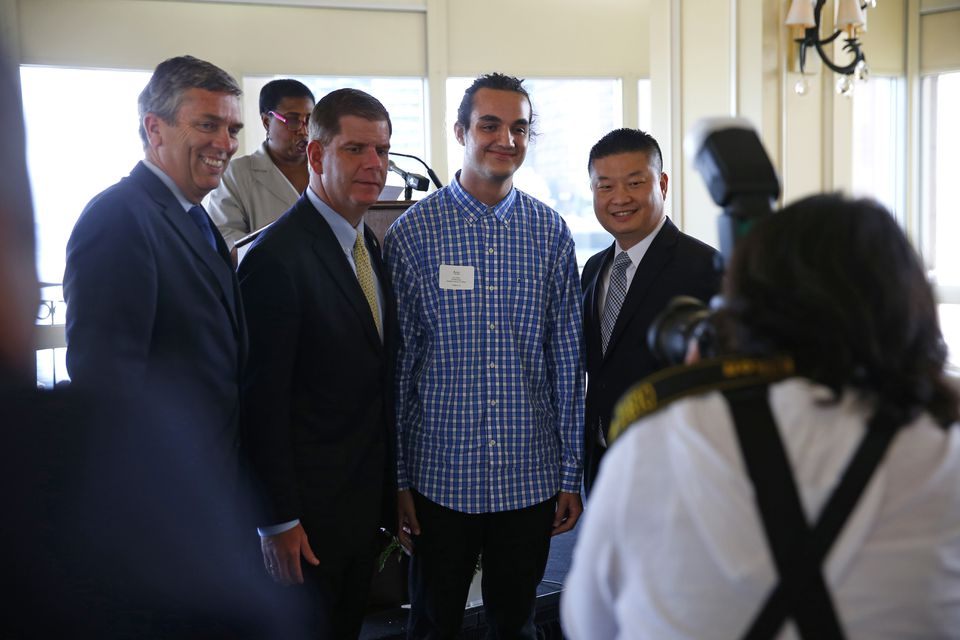 Joel Ortiz (second from right) was recognized by Boston Mayor Marty Walsh (second from left) and then superintendent Tommy Chang (right) for his academic achievements during a 2016 event. California authorities say Ortiz orchestrated a complex scheme that stole $5 million by hijacking the identities of some 40 victims.