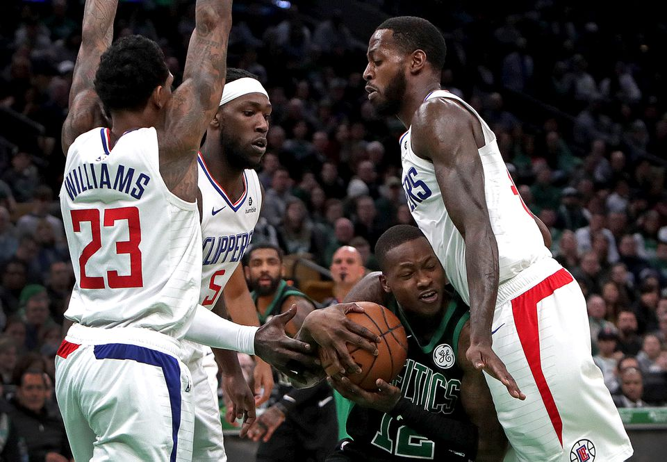 Celtics guard Terry Rozier looks for room to maneuver as the Clippers defense closes in.