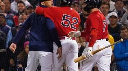 Alex Cora (left) was restrained in an argument with plate umpire Laz Diaz in the third inning.