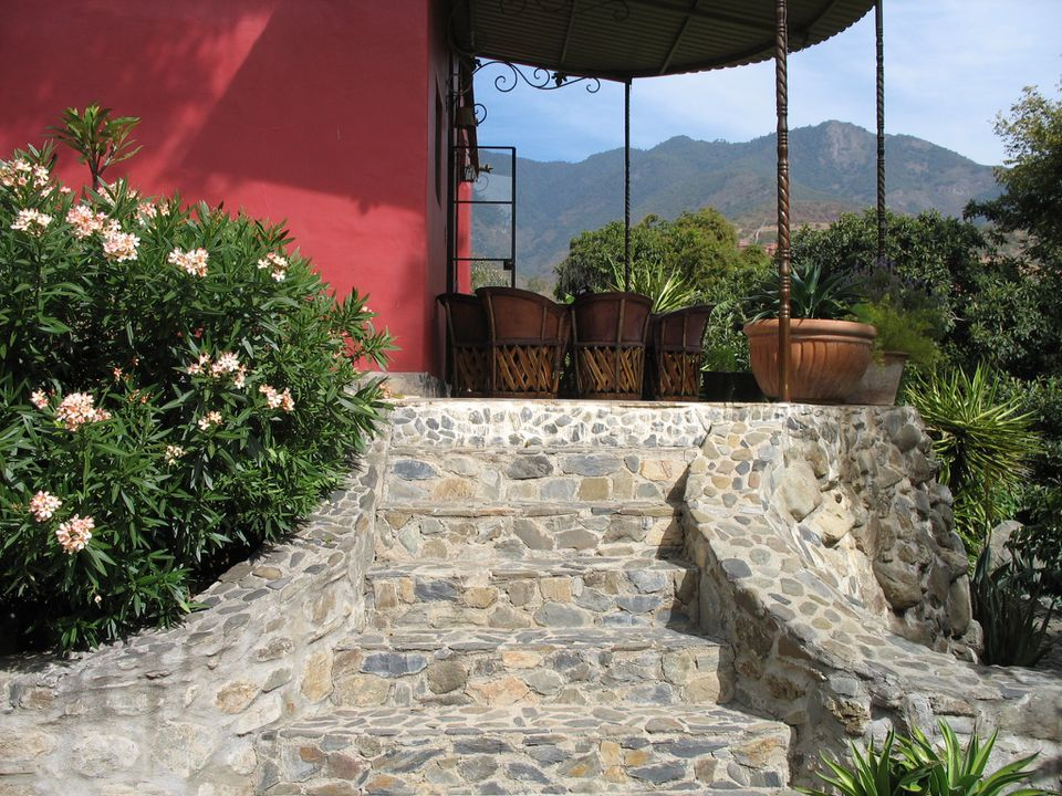 The rental house in Oaxaca, Mexico, had a street-level entry for guests unable to use these stairs. A hammock hung on the porch of the guest cottage.