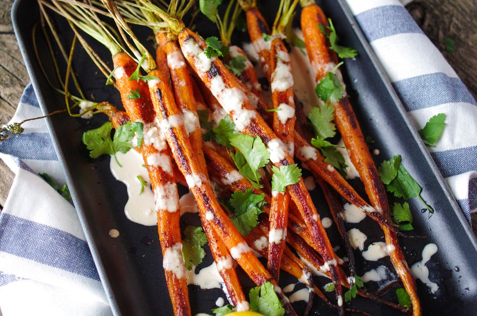Tahini drizzled over roasted carrots.