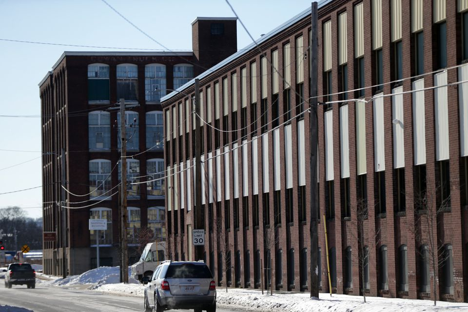 """One way cannabis companies make these old buildings clean and nontoxic for the plant is to retrofit the building with stackable modules or """"plug and play"""" grow boxes, which look like shipping containers."""