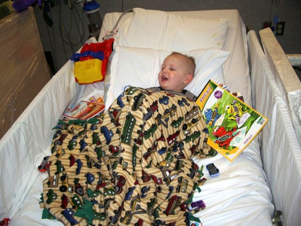 Will at the Children's Hospital of Philadelphia, preparing to receive an infusion that would make him radioactive. Note the lead-lined shields on either side of the bed to protect people from him.