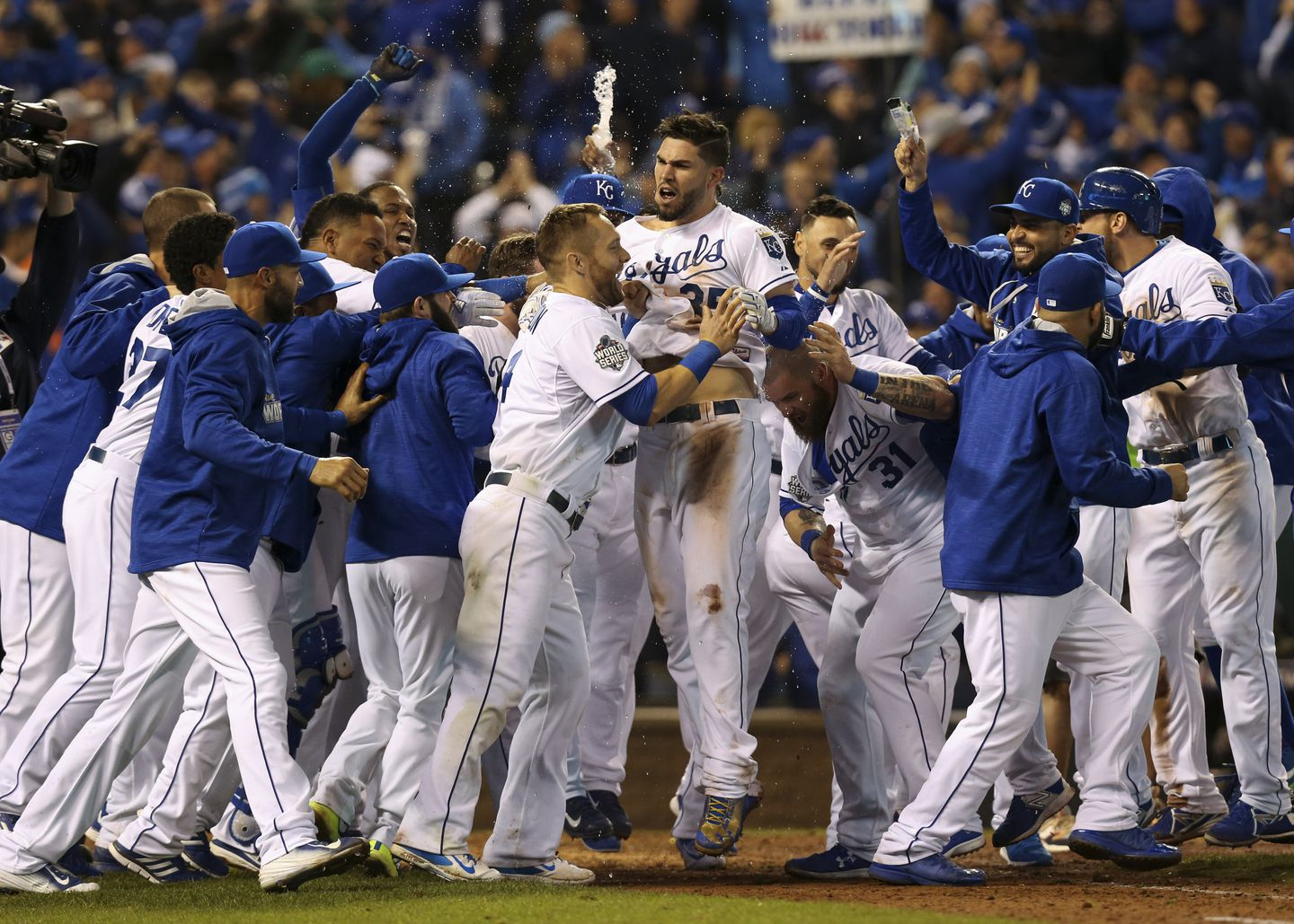 618aae8fc Eric Hosmer (35) was at the center of the celebration after his sacrifice  fly
