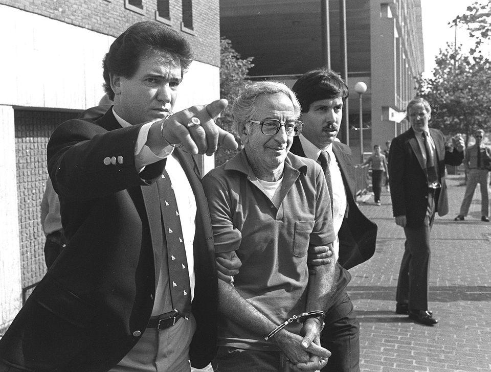 FBI agent John Connolly Jr. (left) took Francesco Angiulo (center) to court in 1983.