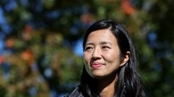 Boston Mayoral Candidate Michelle Wu listens as Senator Ed Markey speaks at a Climate Canvass Kickoff in Moakley Park on Oct. 17.