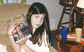 """The author and a prized """"Harry Potter"""" book many years ago."""