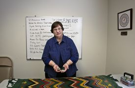 """Donna Doucette, executive director of VOTF, holds objects used as """"talking pieces"""" in healing circles."""
