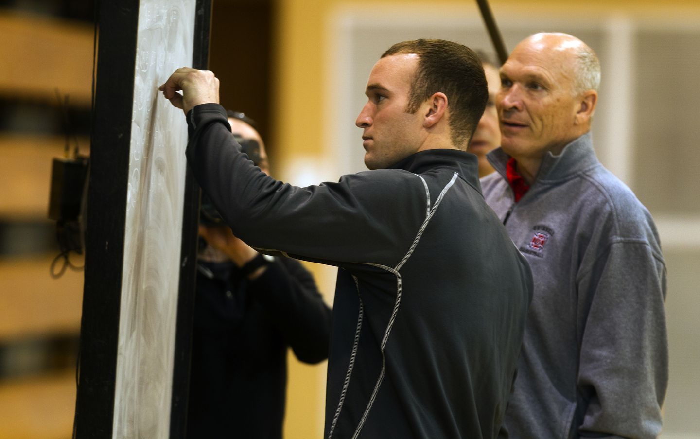 Associate head coach David Arseneault Jr. (left) and head coach David Arseneault Sr. have drawn up a high-scoring, run-and-gun offense.