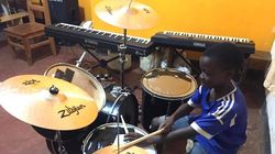 Musary has been providing instruments (including this drum kit) for students in the music room of a community center in Tanzania.